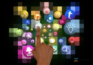 a photo of a finger hovering over multiple social media icons